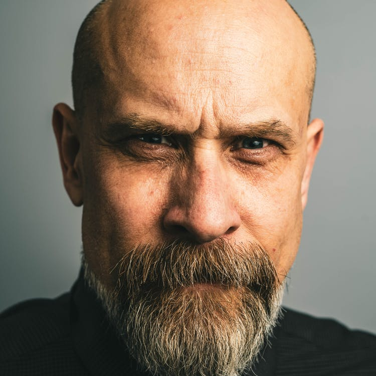 Bald Man with a Serious Facial Expression