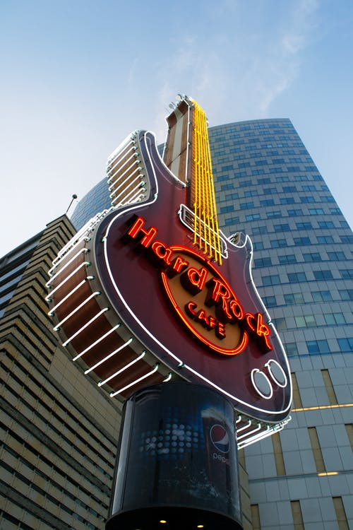 Low Angle Photography of Hard Rock Cafe Guitar Signage