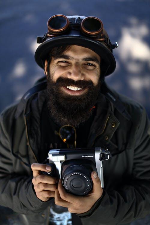 Man Smiling Holding Camera