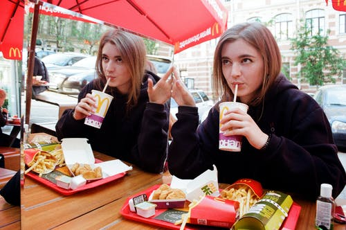 Photo of a Woman Eating on McDonald's