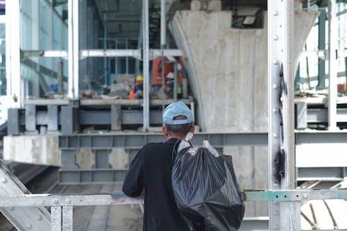 Gratis lagerfoto af arbejdstagere, bygningsarbejder, bygningsarbejdere, byområde