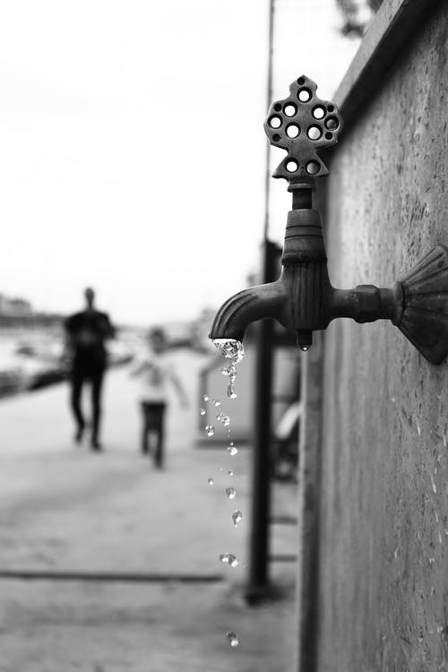 Grayscale Photography of a faucet