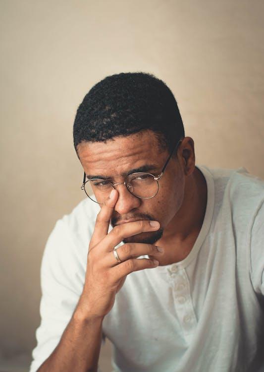 Photo of Man Wearing Eyeglasses