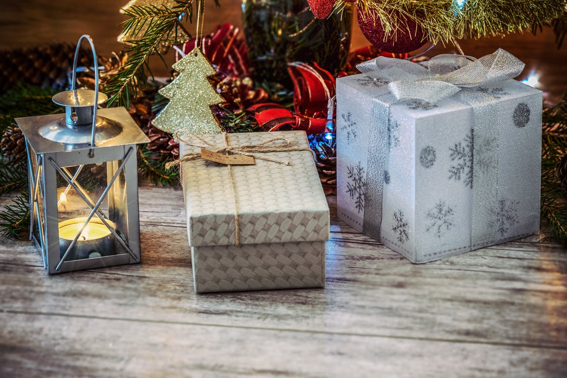 Two Gray and Beige Gift Boxes Beside Gray Metal Lantern