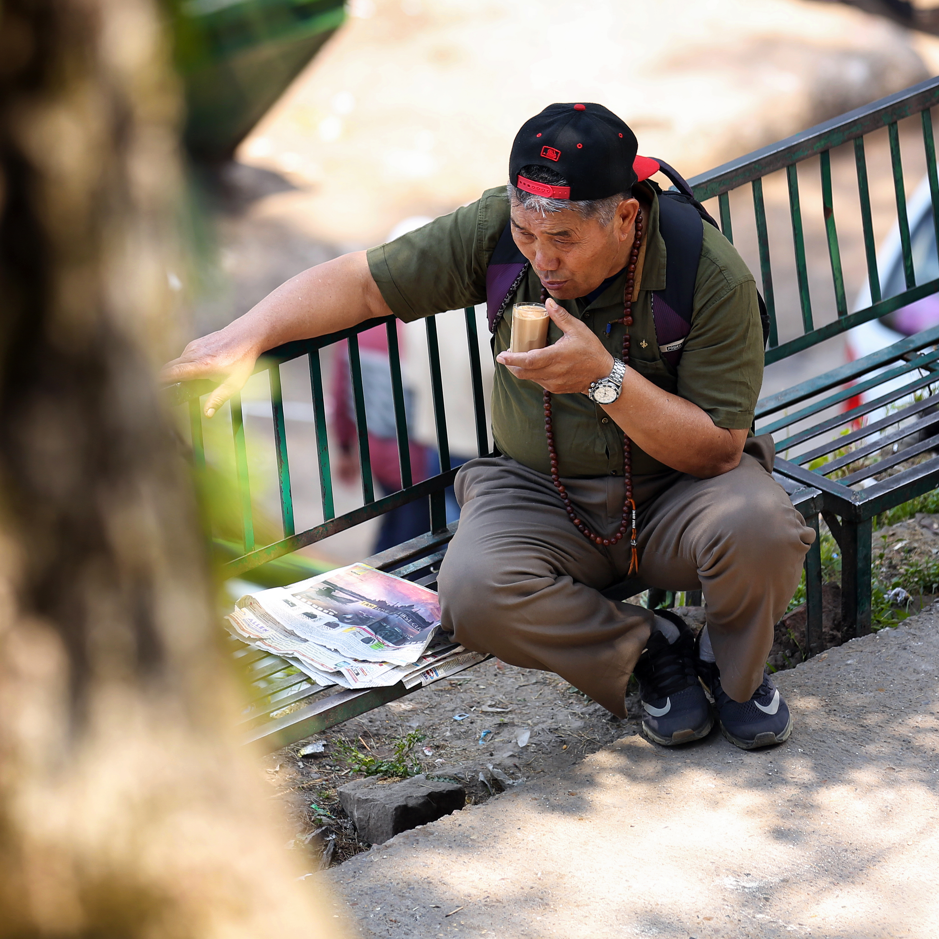 Man Sitting on Selective Focus Photography