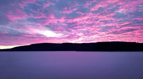 Free stock photo of clouds, cloudy sky, frozen lake, pink sky