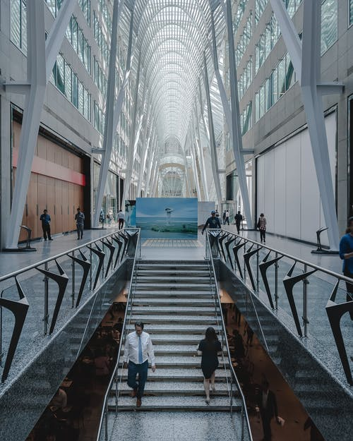 People Walking Inside Glass Building