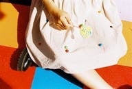 Unknown Person Holding Lollipop
