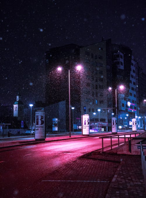 Street Lights Turned on Near Buildings at Night