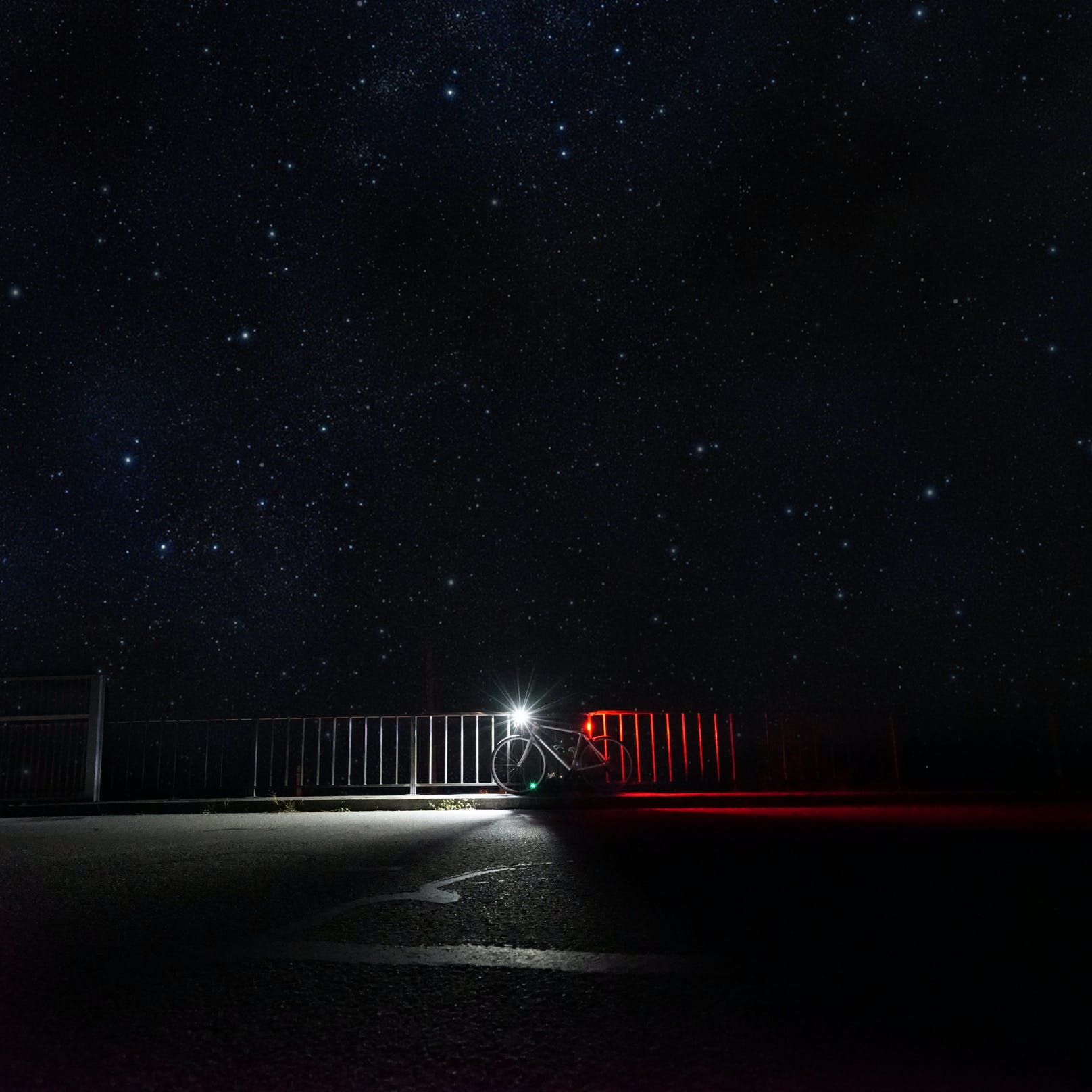 Bicycle With Light Parked Under Starry Sky