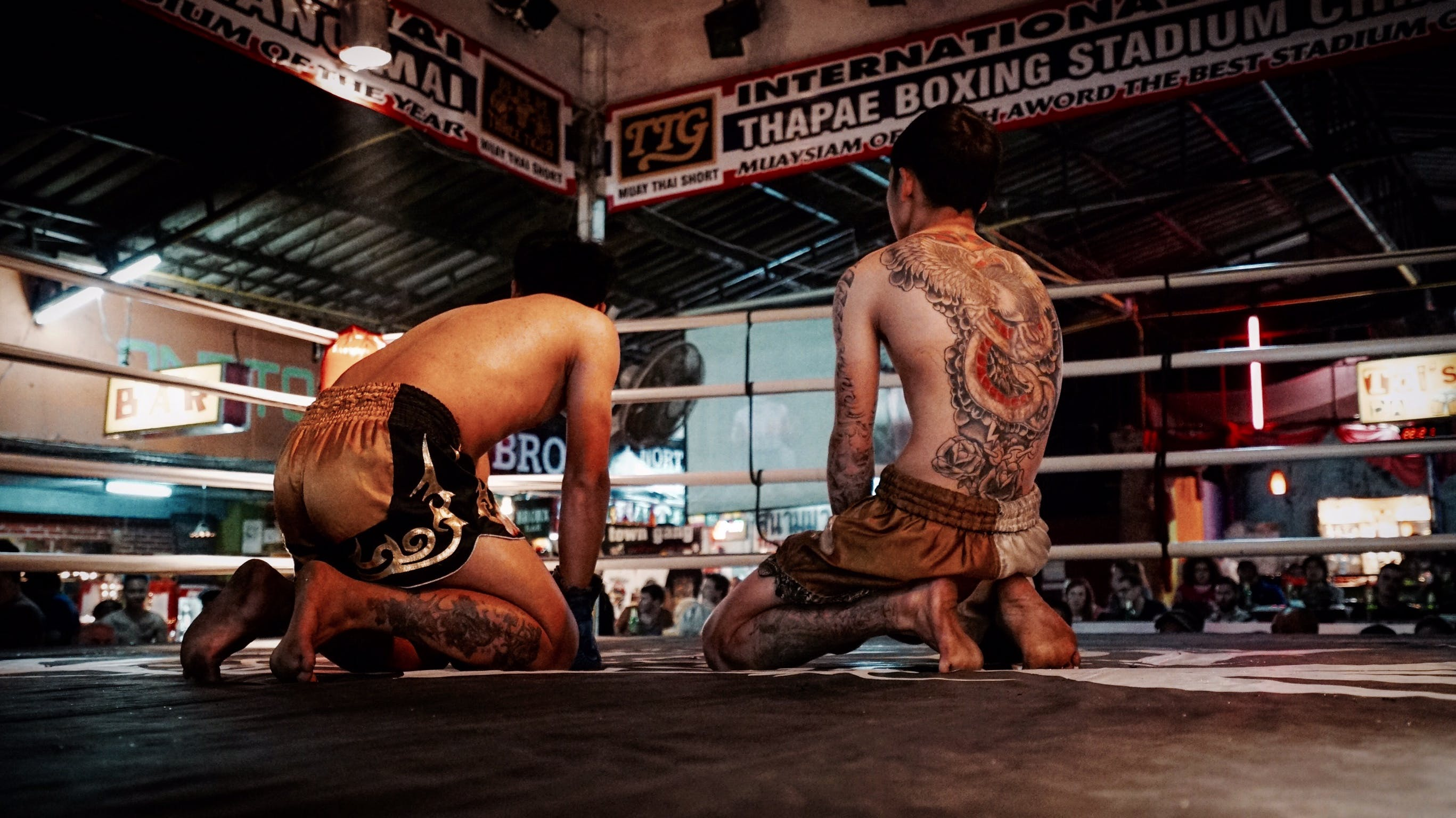 Man Kneeling on Boxing Ring