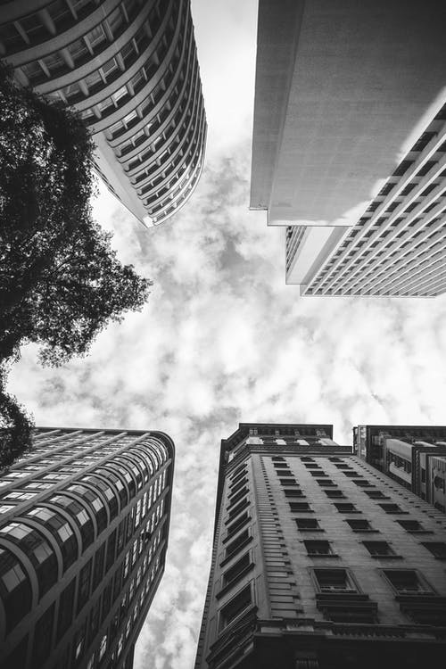 Low Angle Photography of Buildings in Grayscale Photography