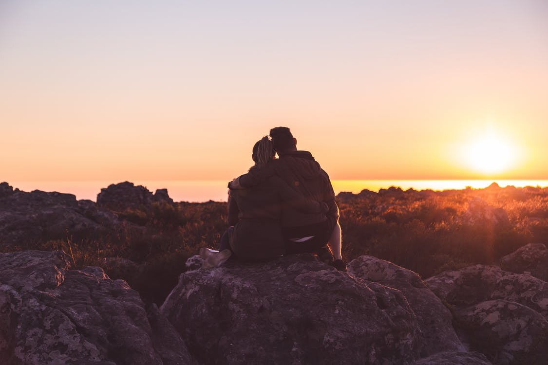 Couple on Top of Rocks