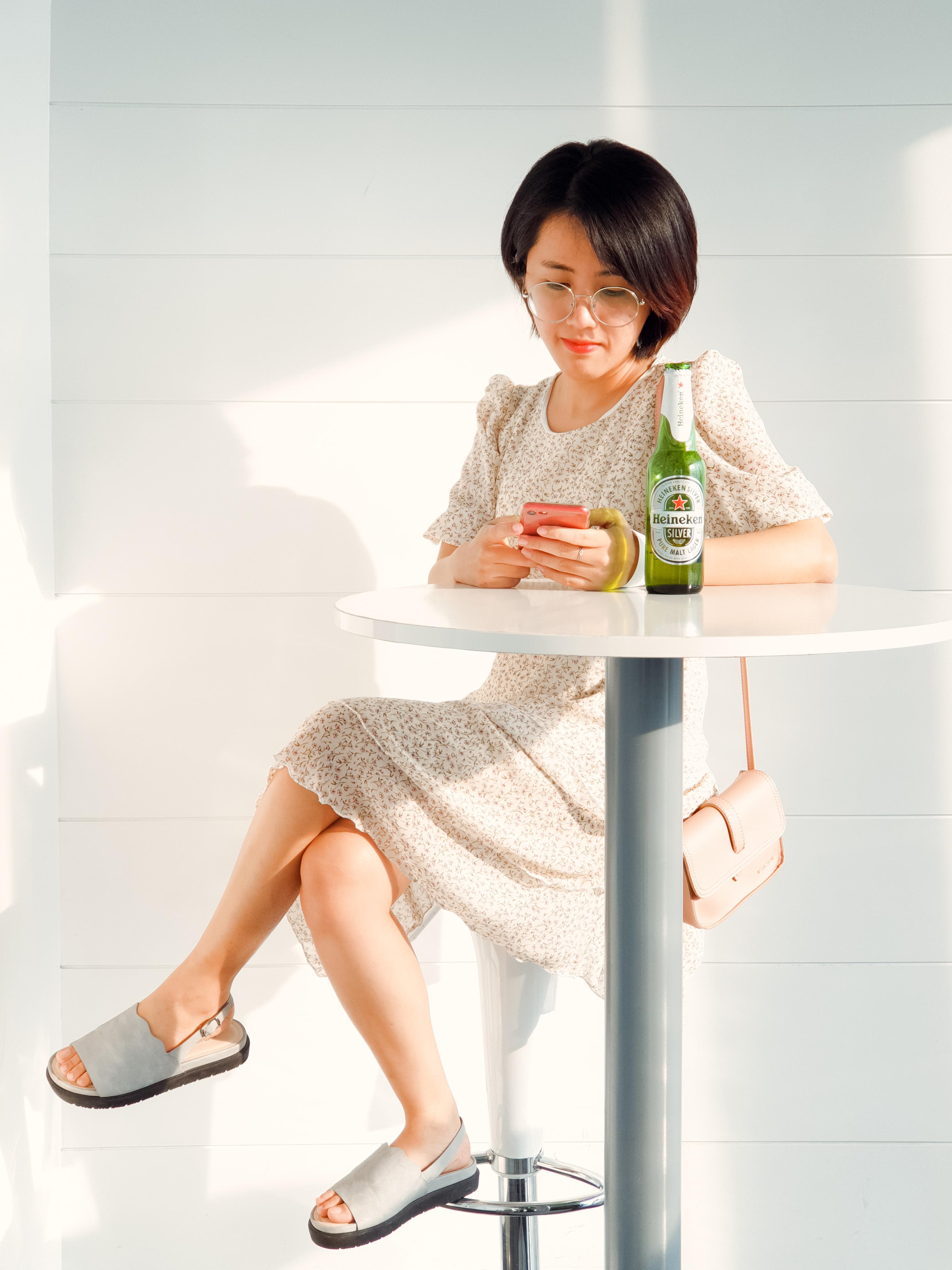 Woman Sitting on Bar Stool