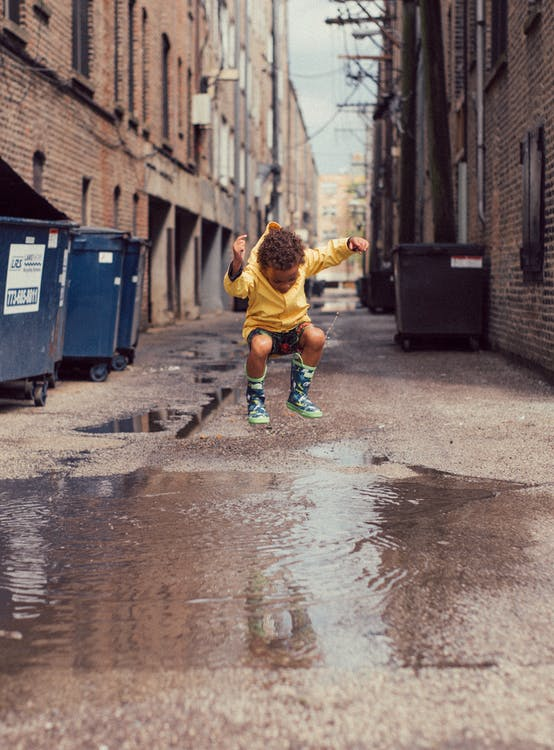 Child Jumping Into Body of Water