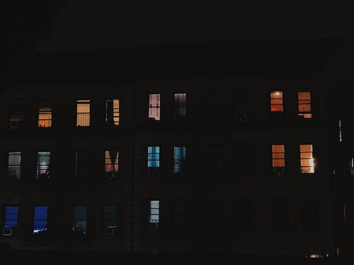 Multi-storey Building With Open Windows during Nighttime