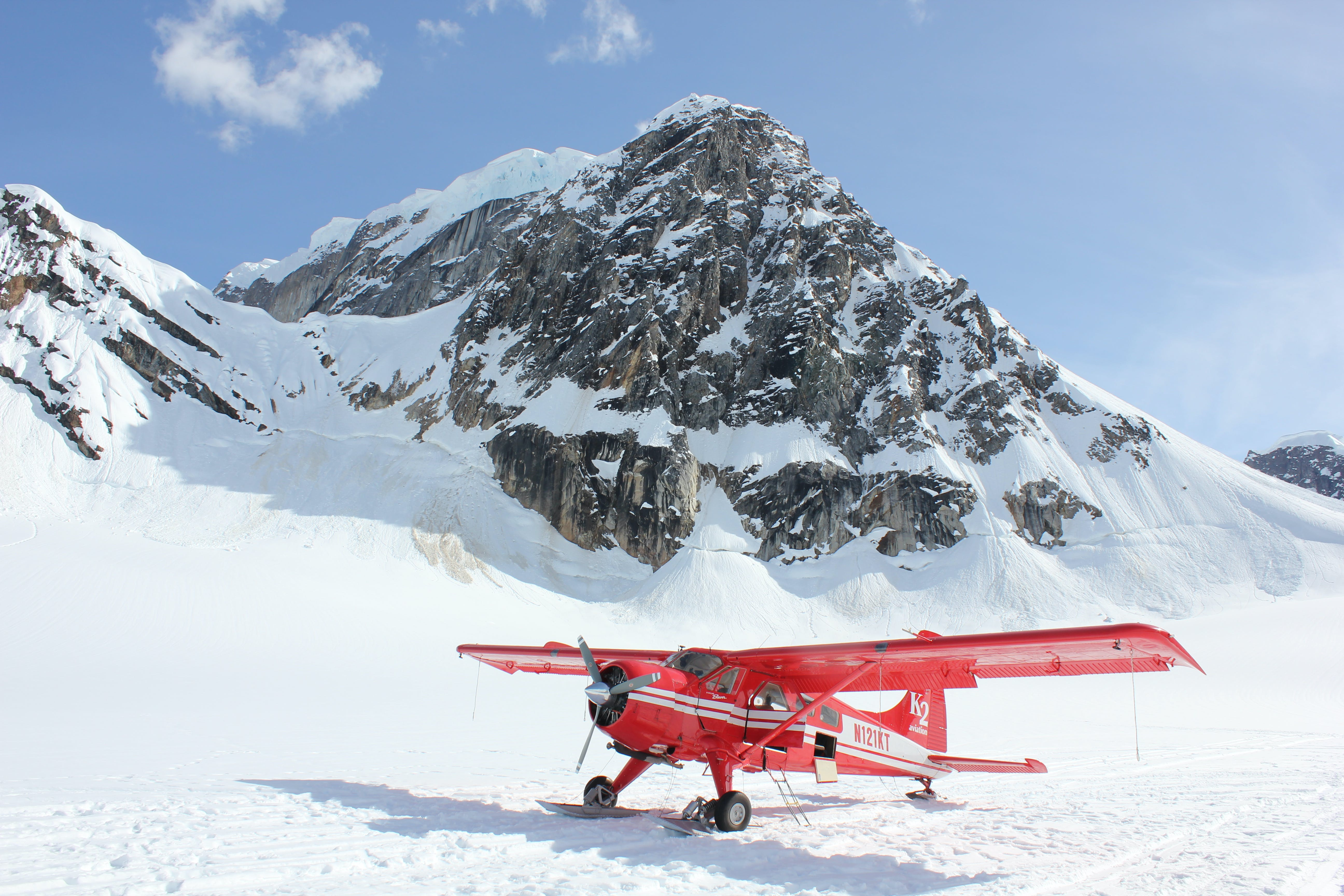 Red Monoplane in Alps