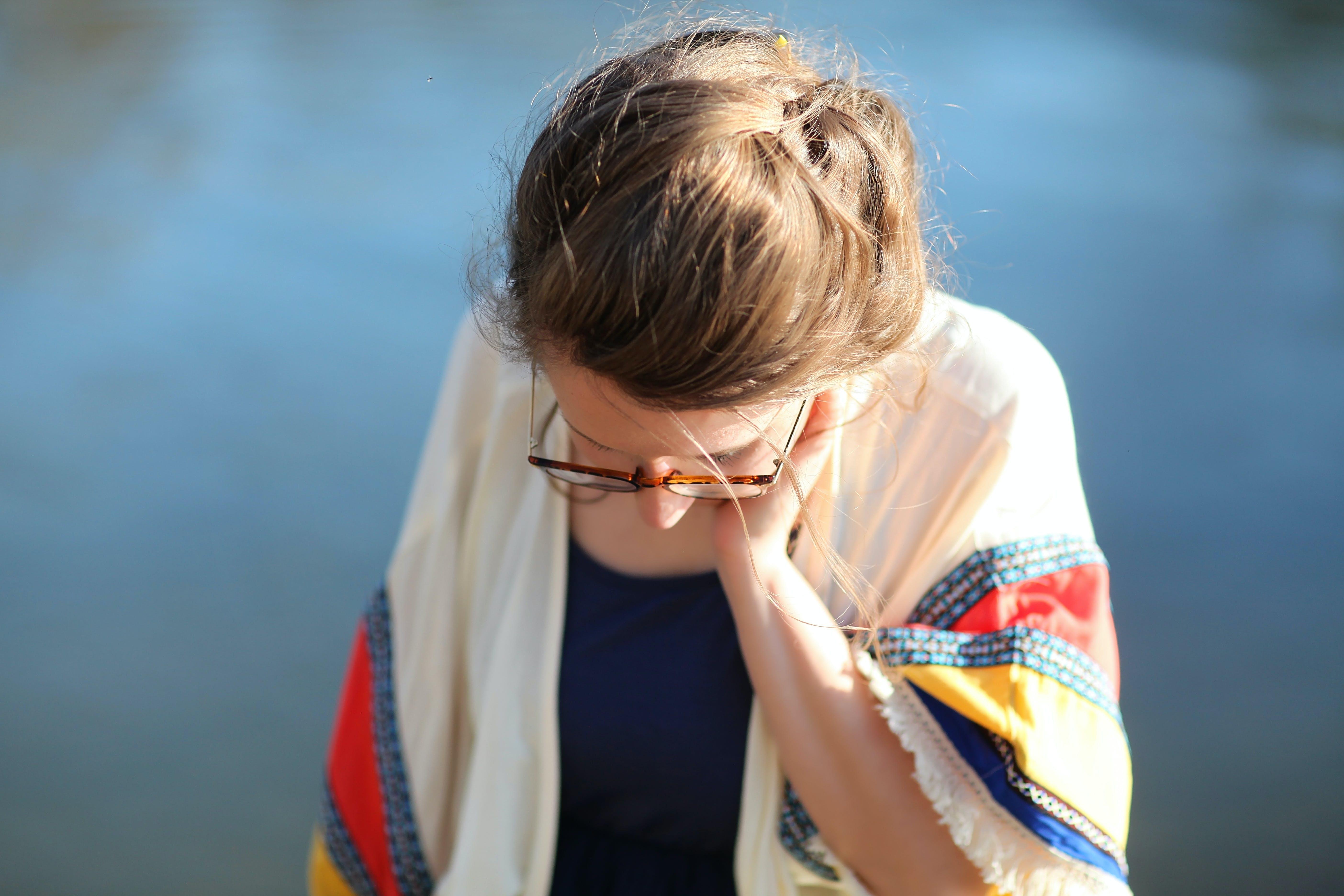 Woman Wearing Eyeglasses on Selective Focus Photo