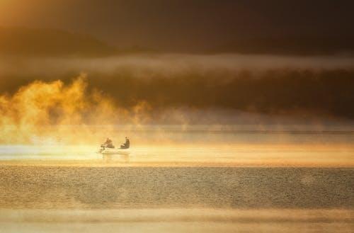 Free stock photo of fisherman, foggy lakes, foggy morning
