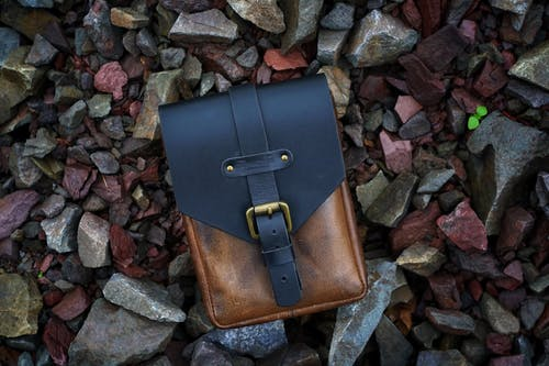 Brown and Black Leather Bag on Stones