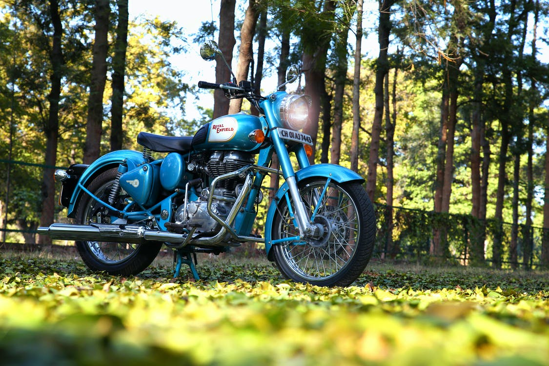 Blue Motorcycle on Green Grass