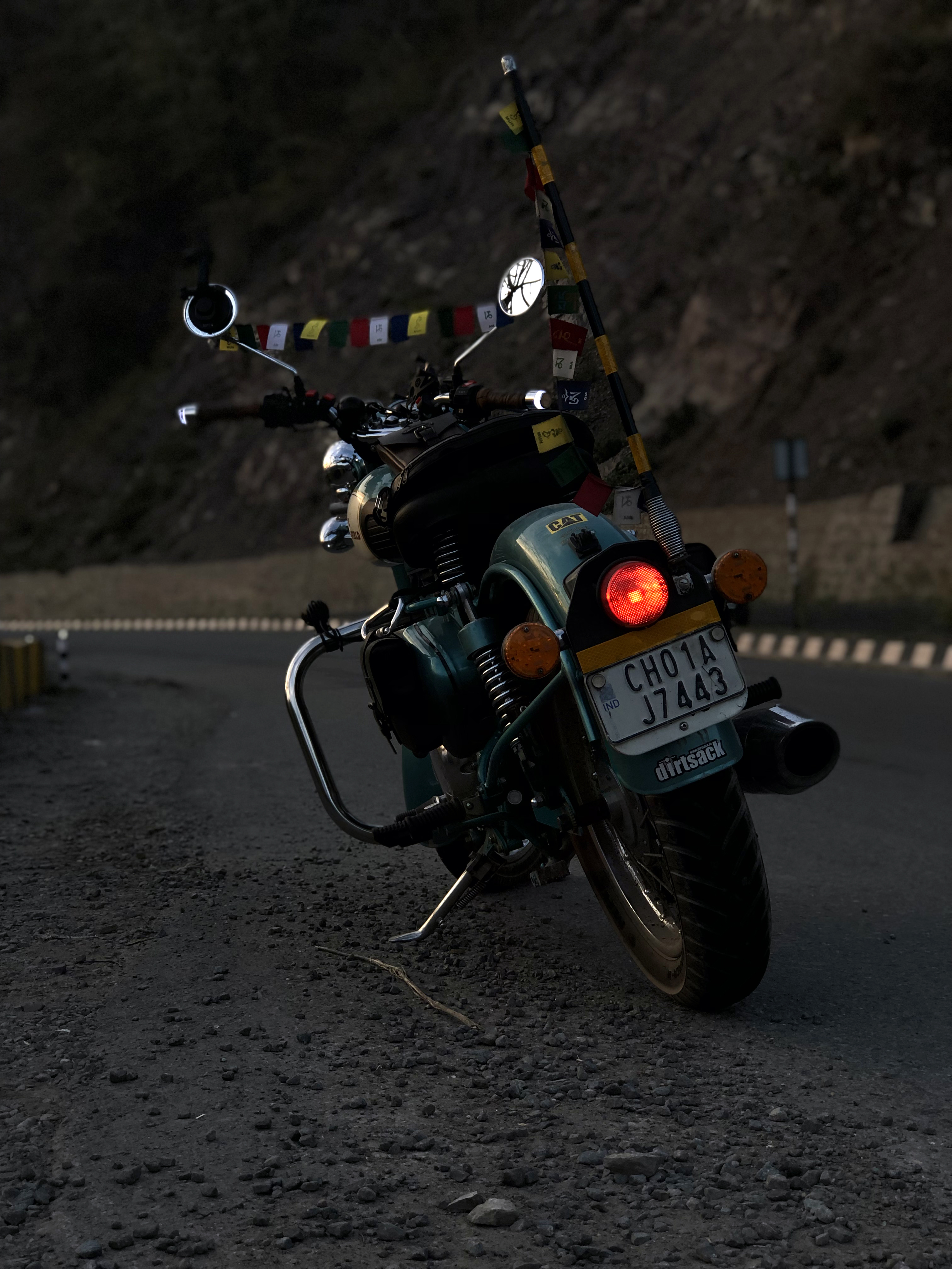 Photo of Parked Motorcycle Beside Road