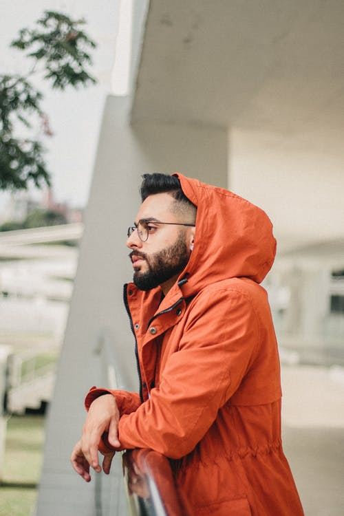 Photo of Man Wearing Orange Jacket