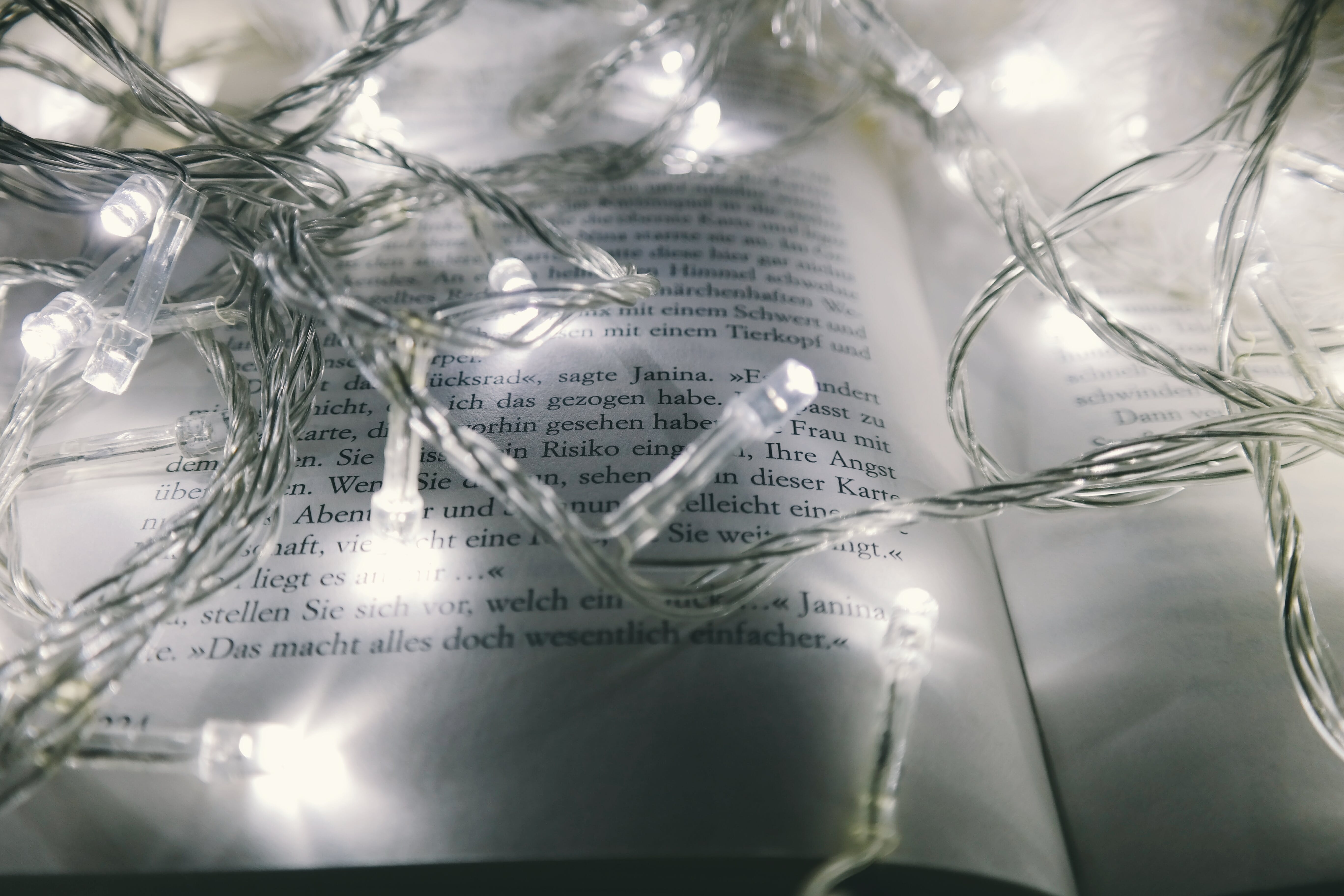 White String Lights Turned-on on Opened Book