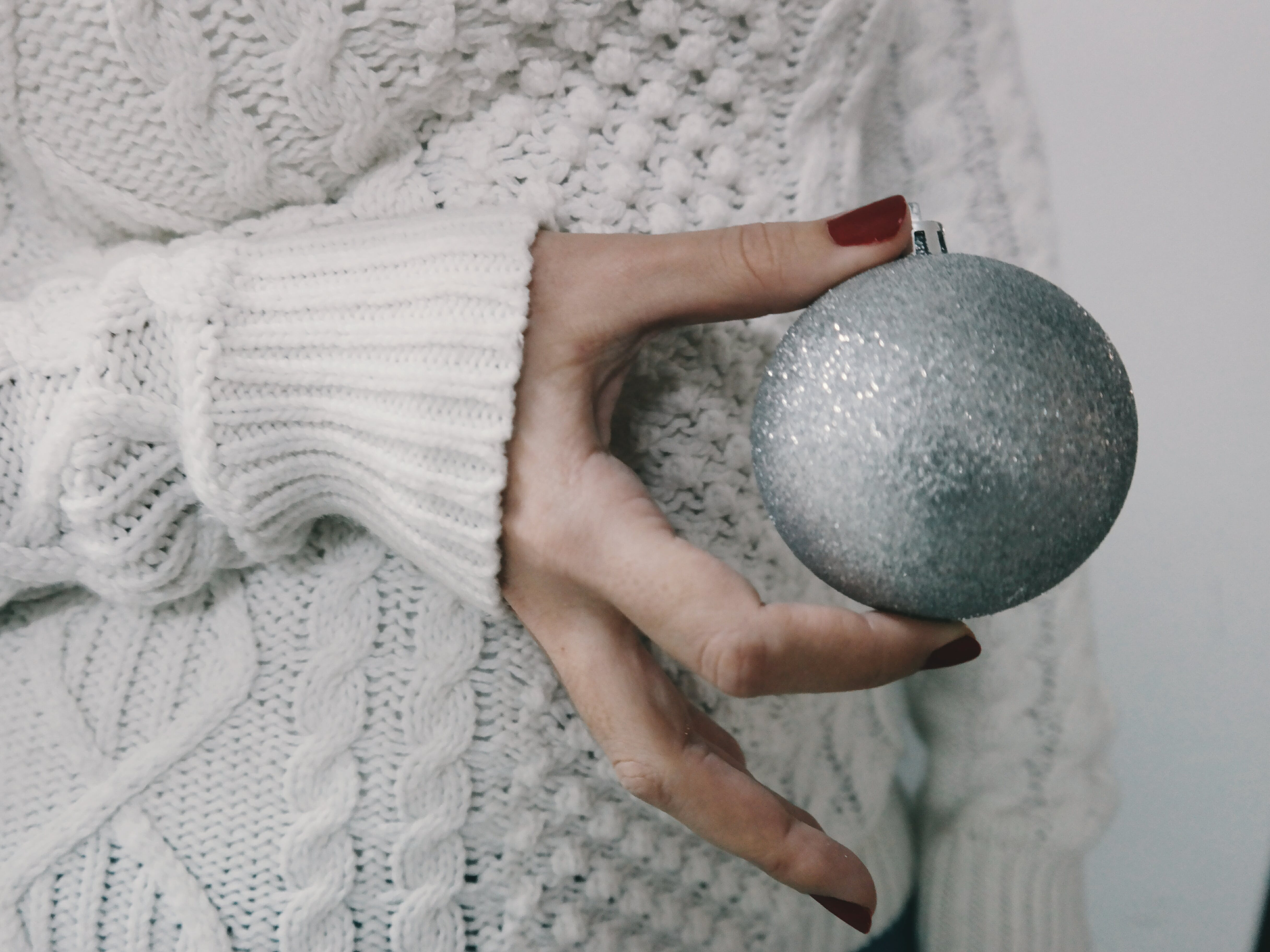 Person Holding Gray Bauble