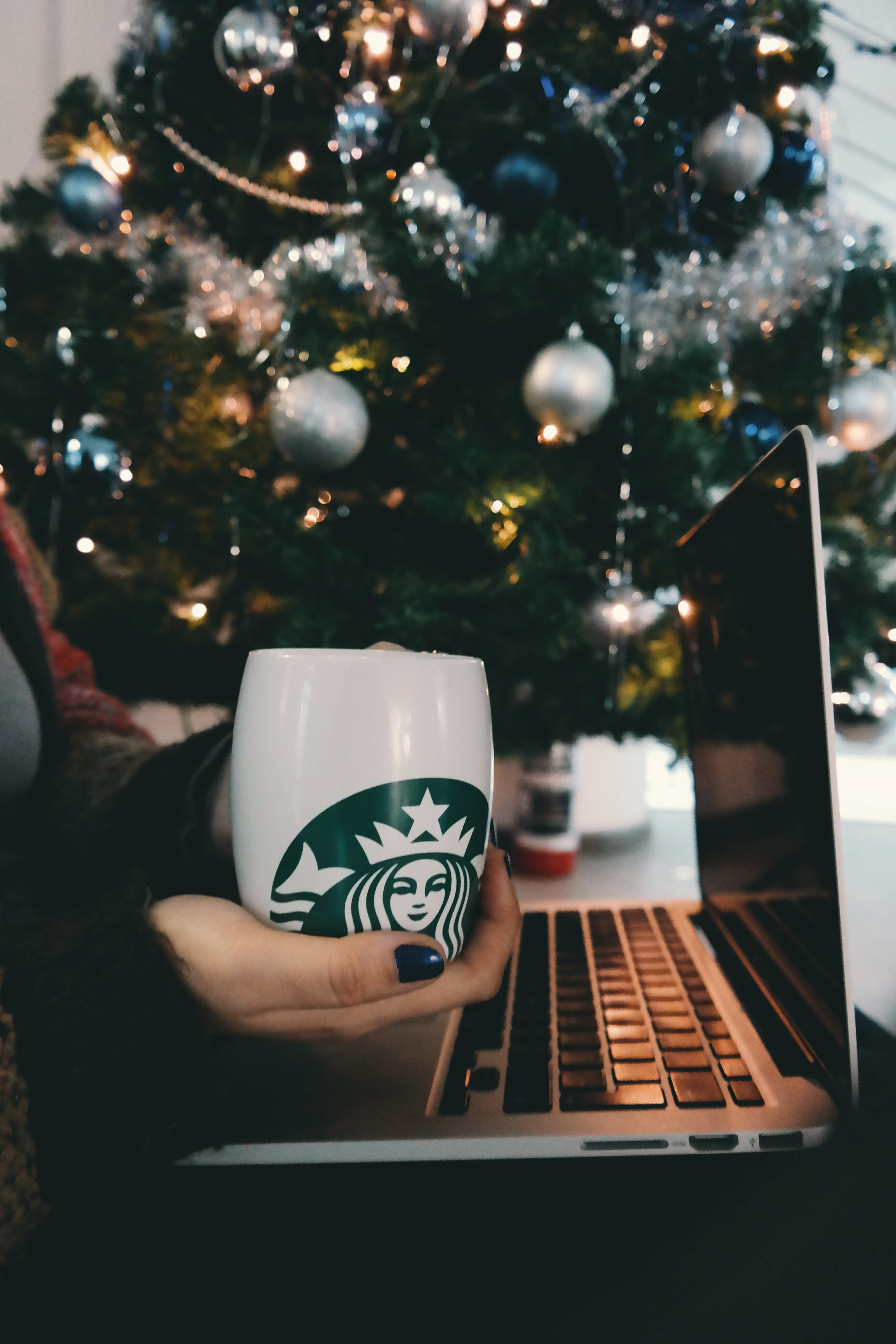 Free stock photo of coffee, hand, mug, laptop