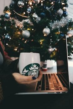 Free stock photo of coffee, hand, mug, laptop