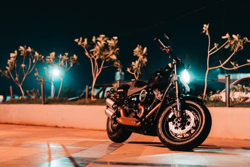 Photo of Black Motorcycle Parked On Pavement