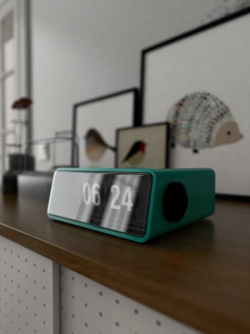 Close-Up Photo of Teal Digital Clock