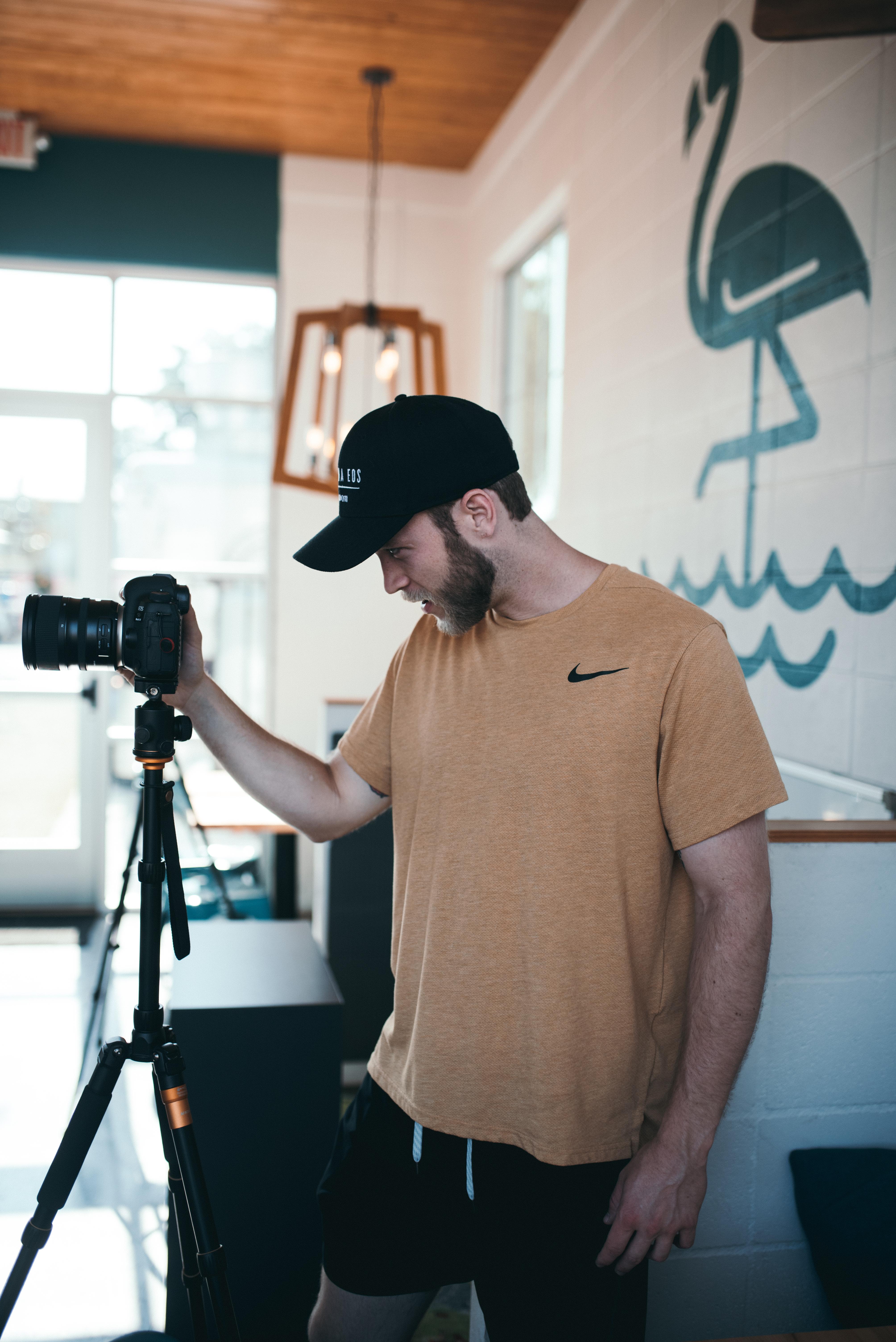 Photo of Man Using Dslr Camera
