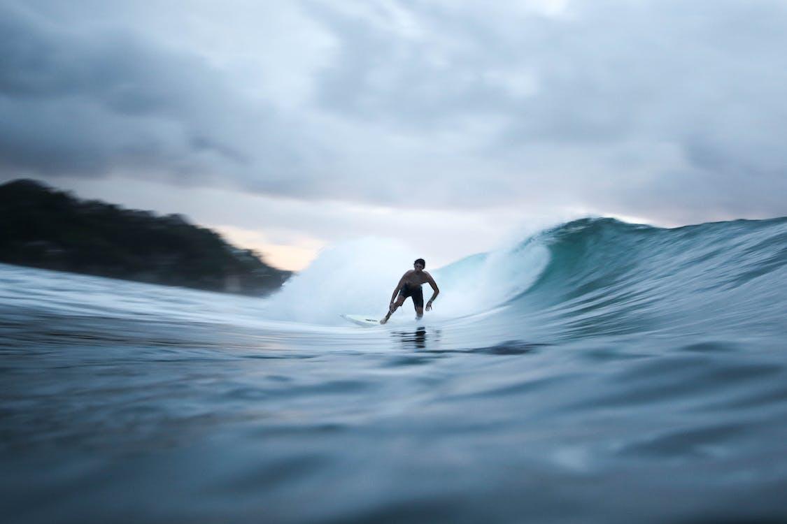 surfer surfing a super nice wave