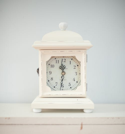 White Table Clock Displaying 12:30