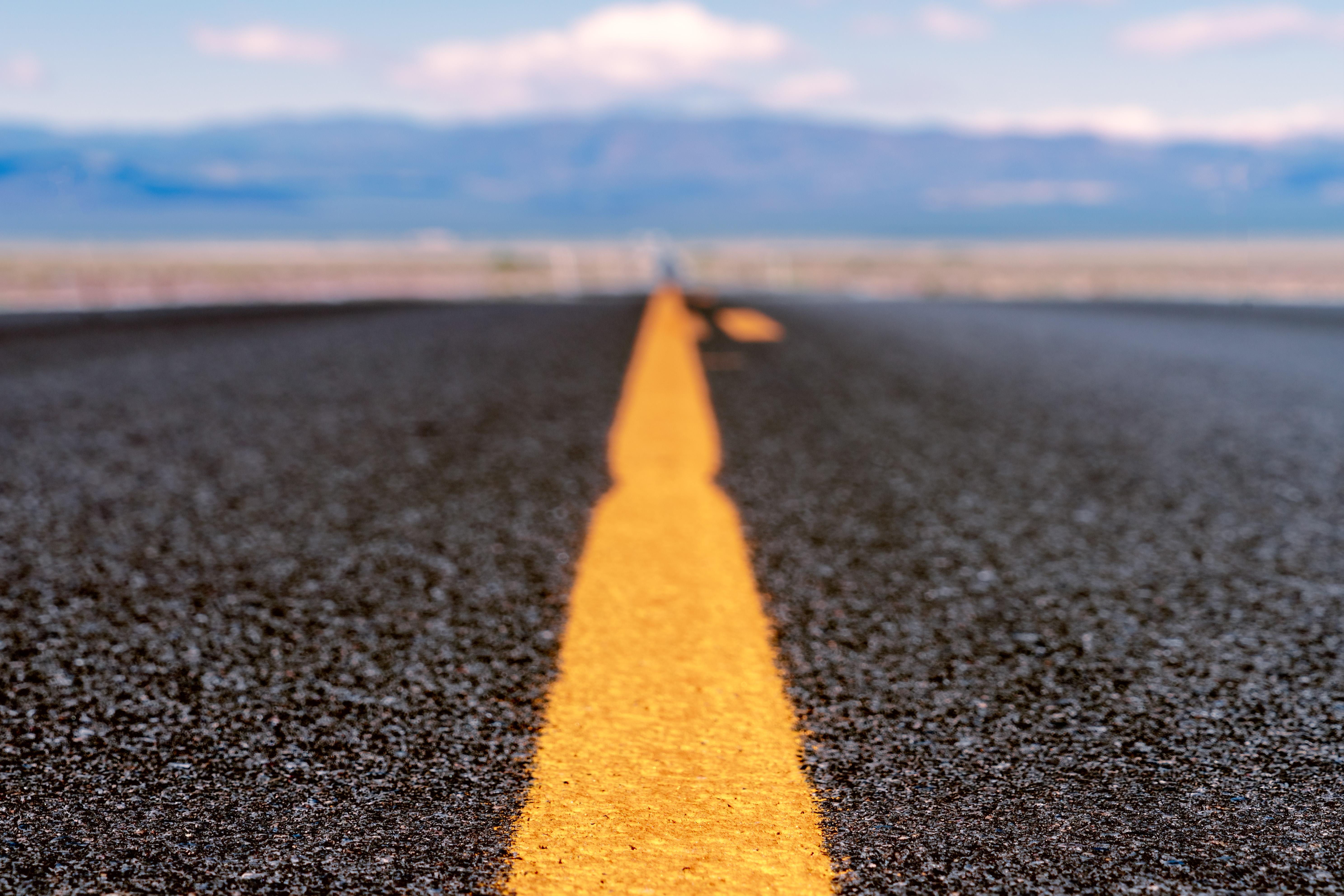 Selective Focus Photo of Asphalt Road