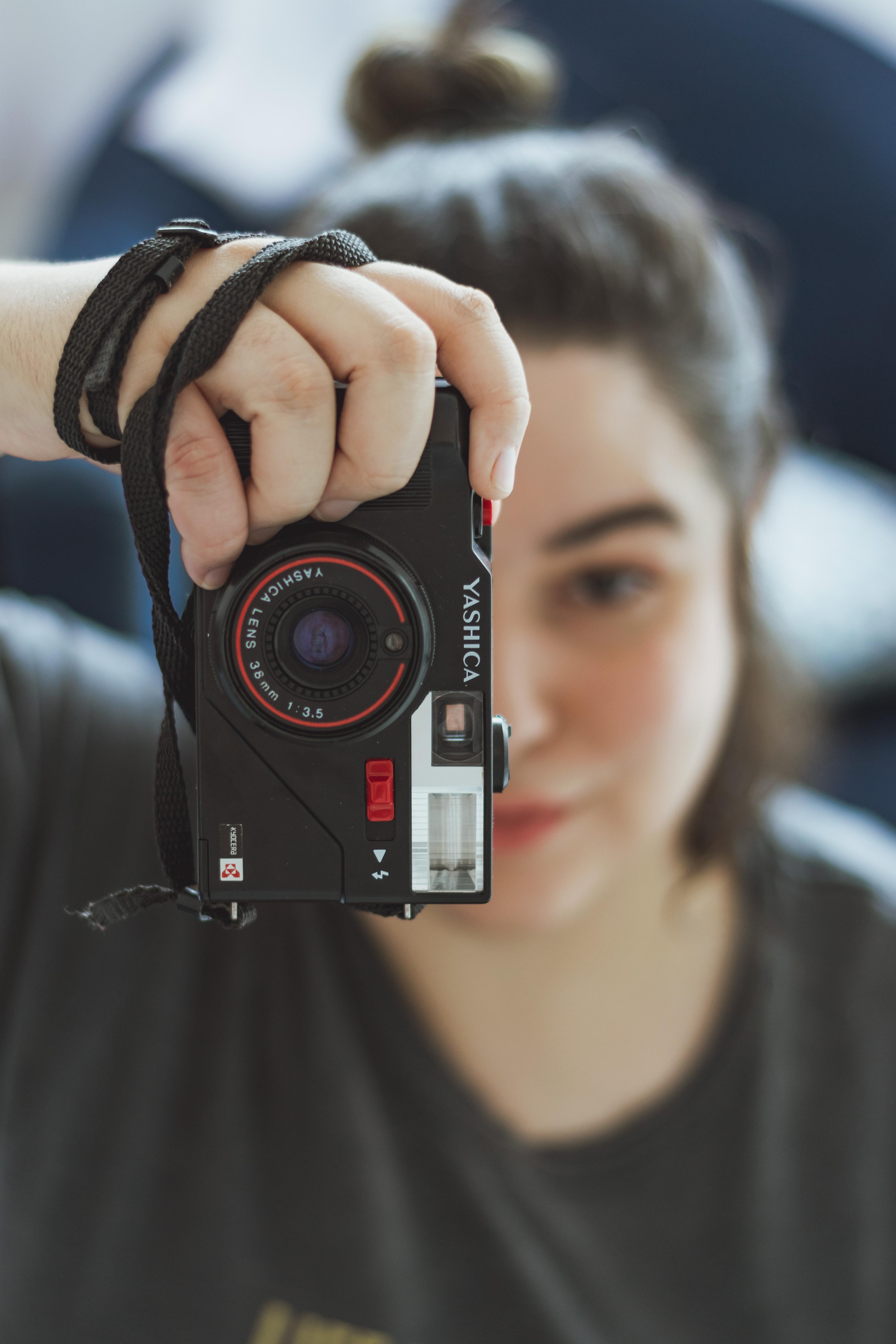 Close-Up Photo of Woman Holding Camera