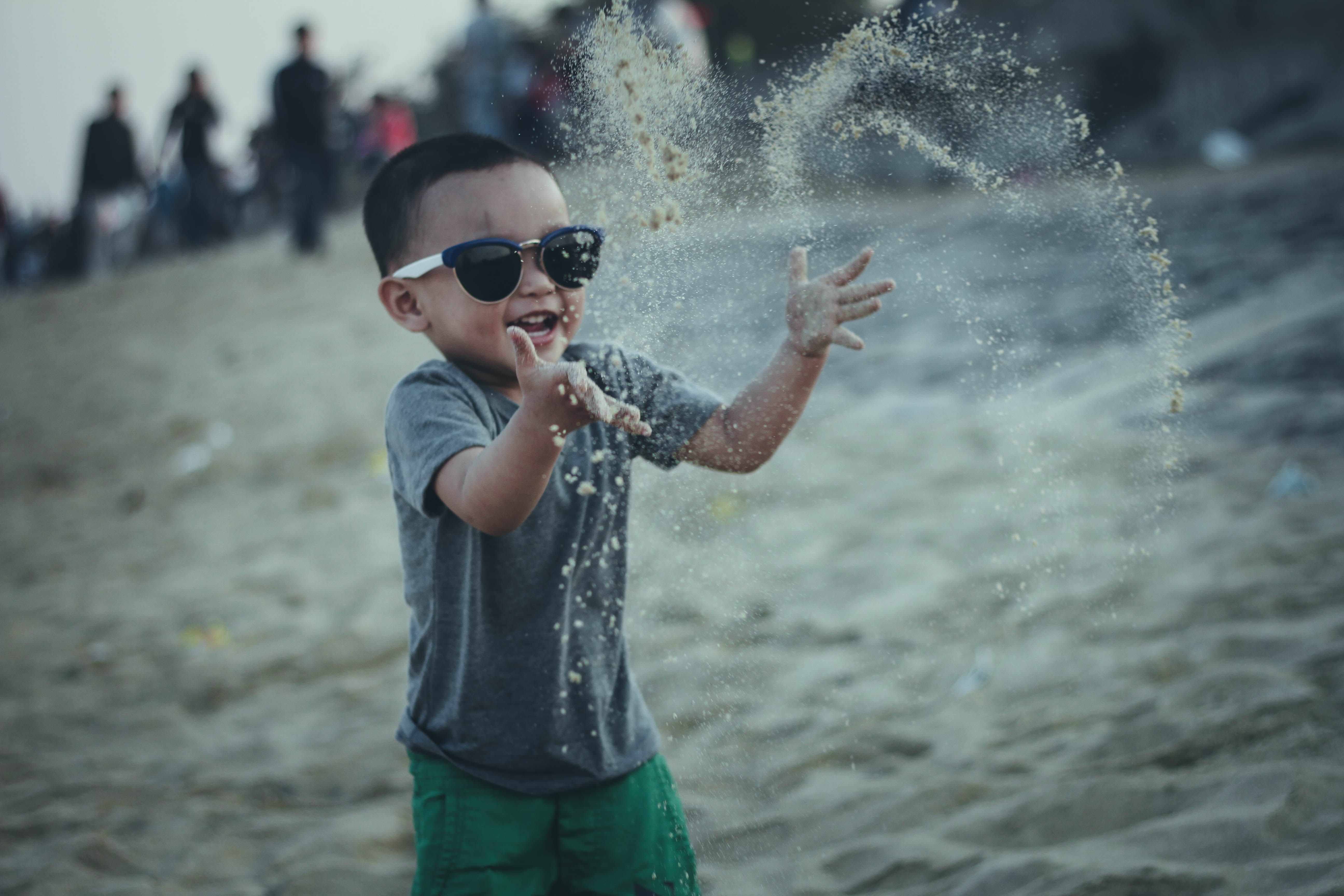 Boy Throwing Sands