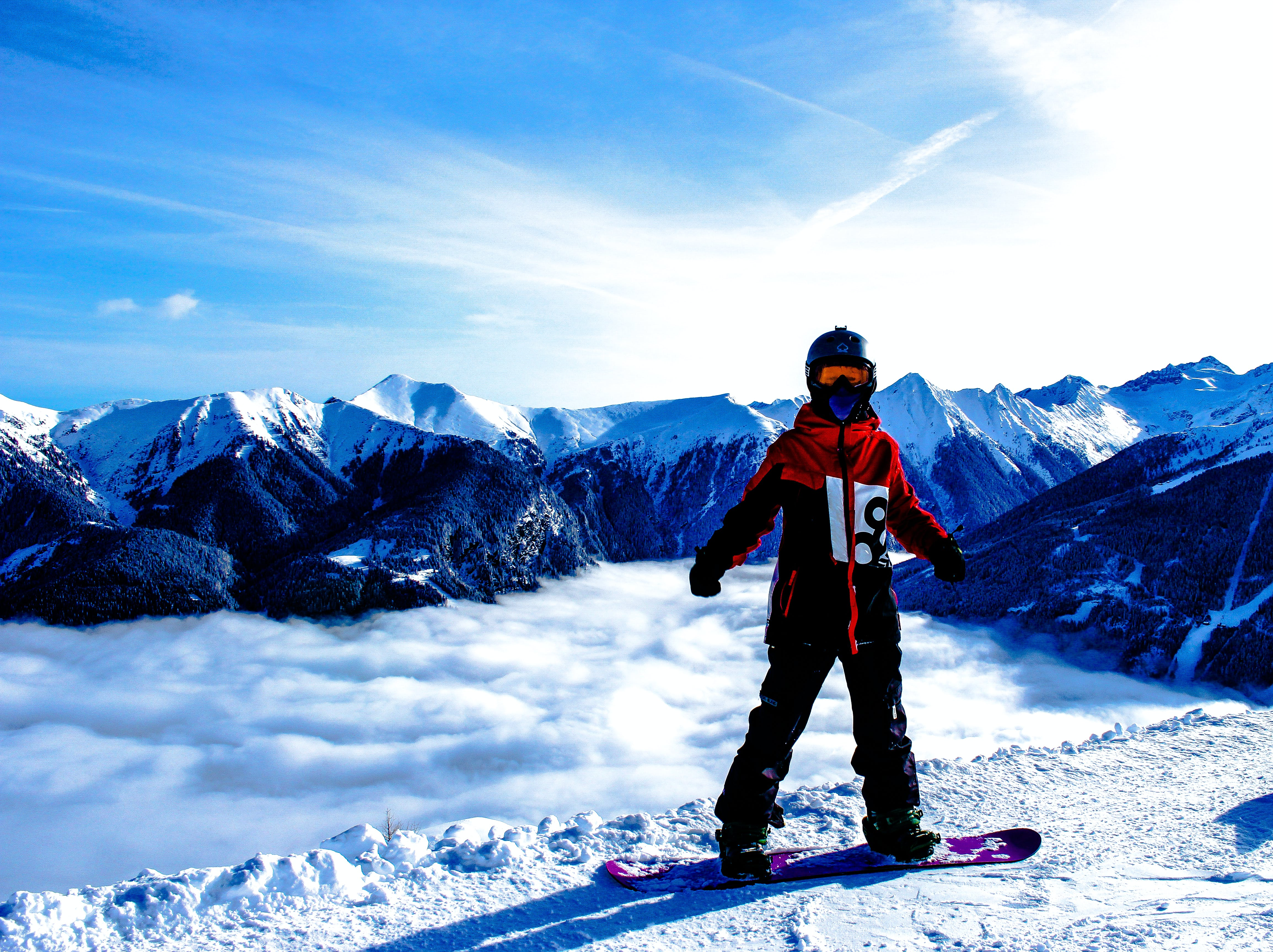 Snowboarded on Snow Covered Mountain