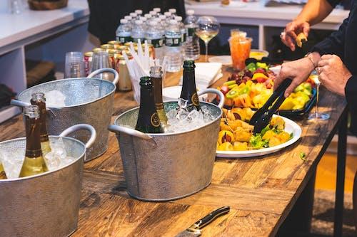 Three Gray Ice Buckets on Table