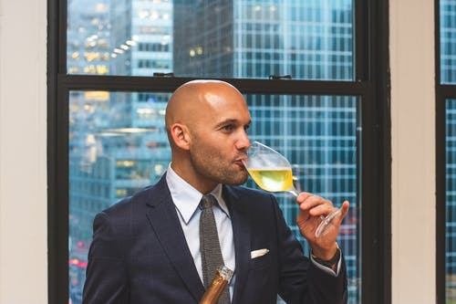 Man Drinking Liquor from Wine Glass