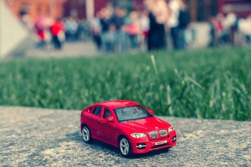 Red Bmw Sedan Tilt Shift Photography
