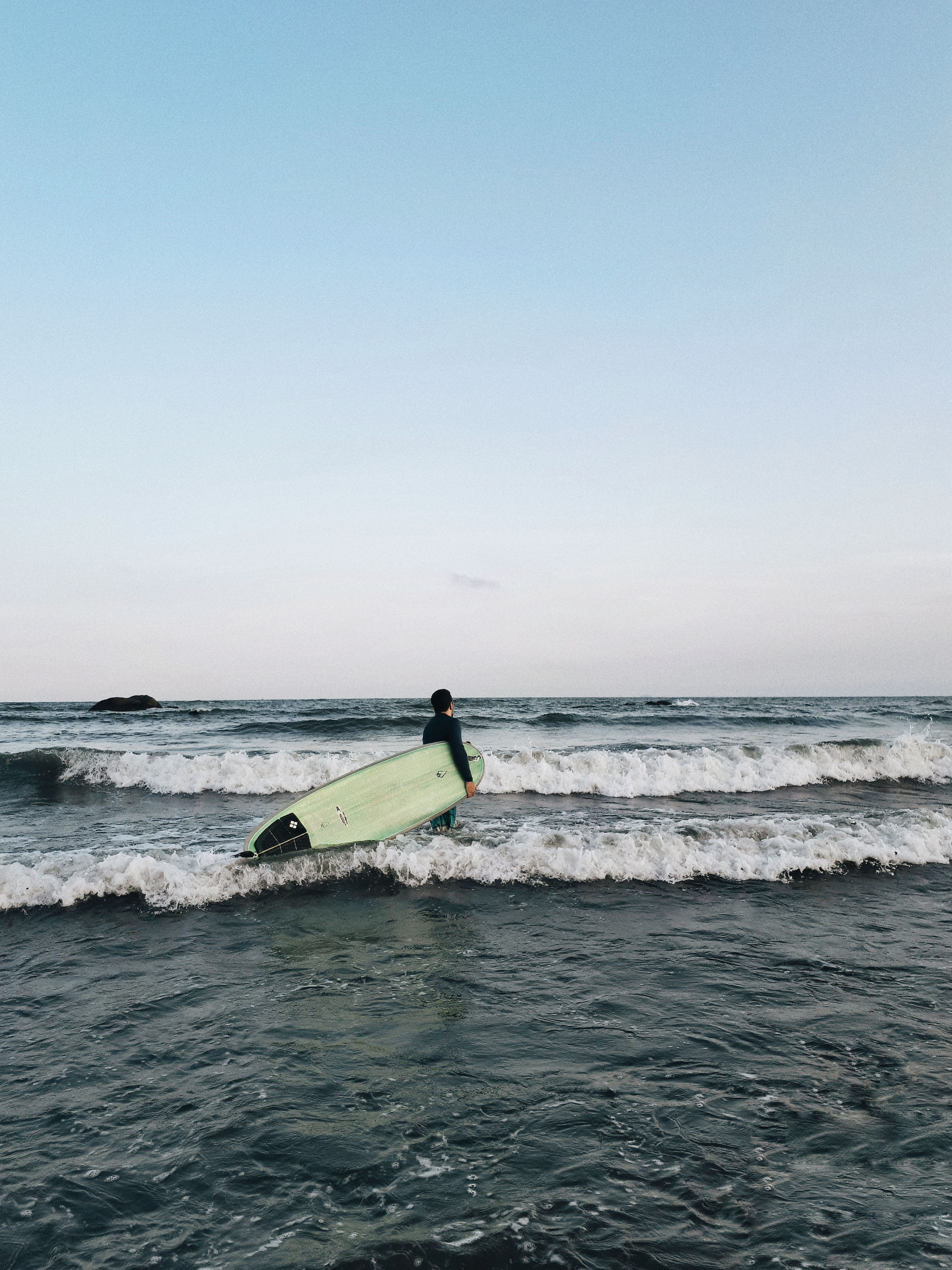 Person Holding Surf Board