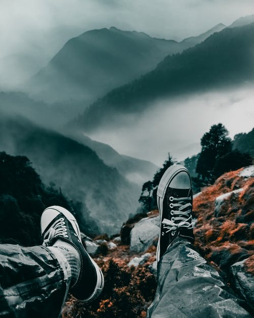 Man Sitting on a Mountain Cliff