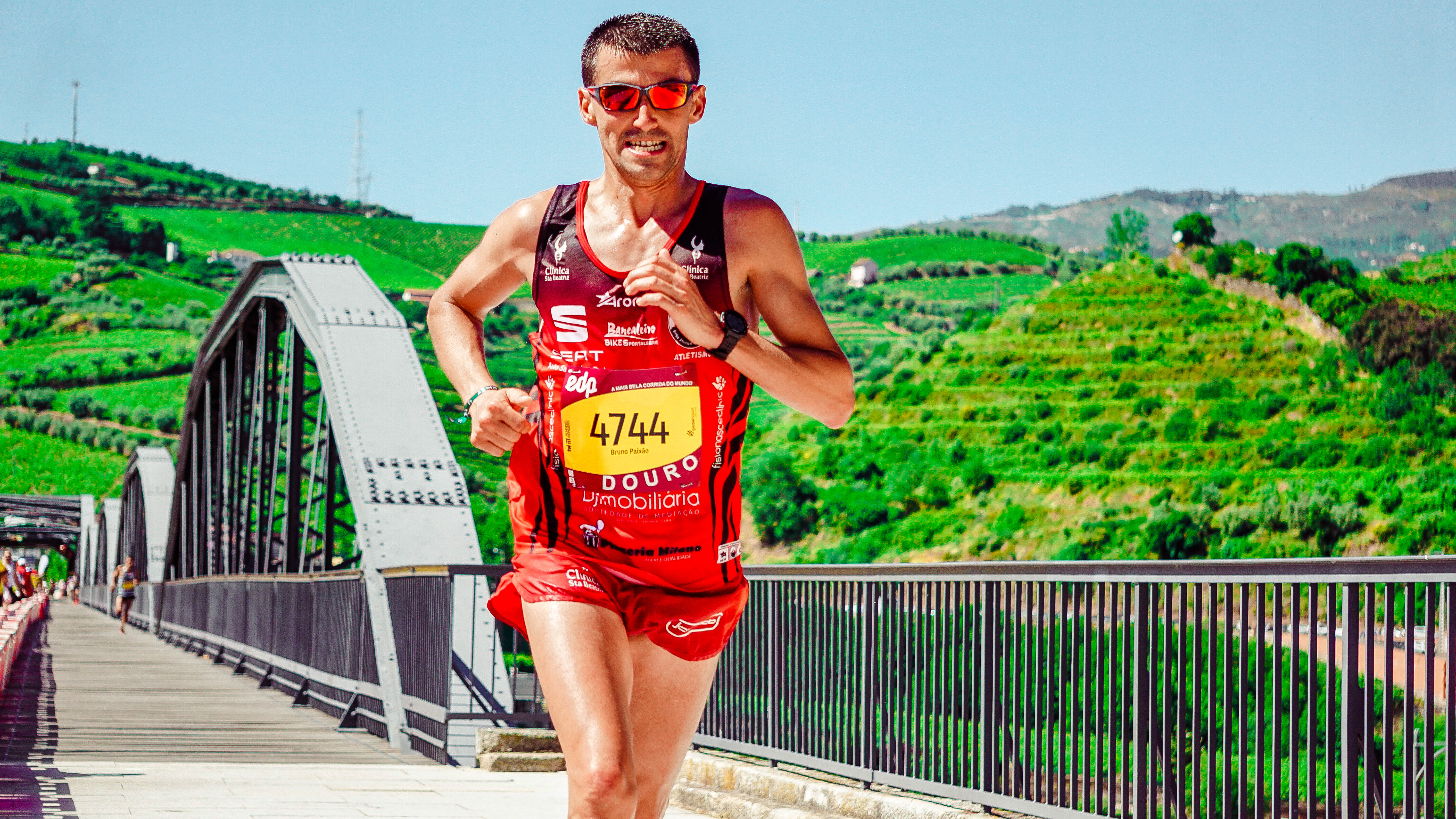 Male Runner Wearing Jersey With Bib Number 4744