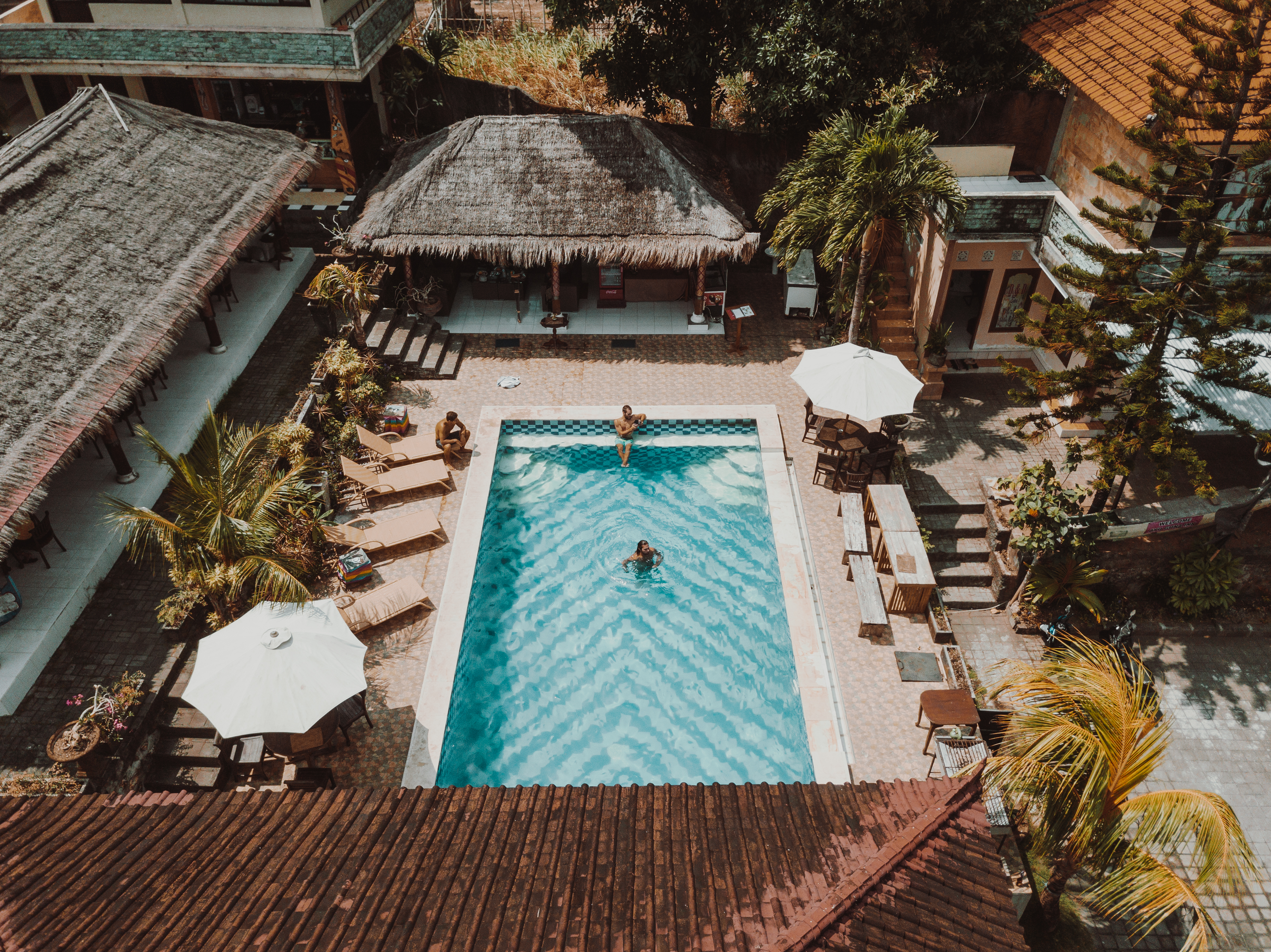 Aerial Photography of Three People in a Swimming Pool