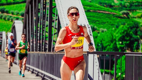 Woman Running on Bridge