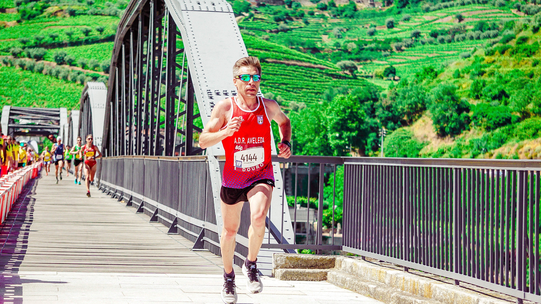 Male Runner Running on a Concrete Bridge