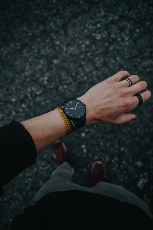 Person Wearing Black Analog Watch